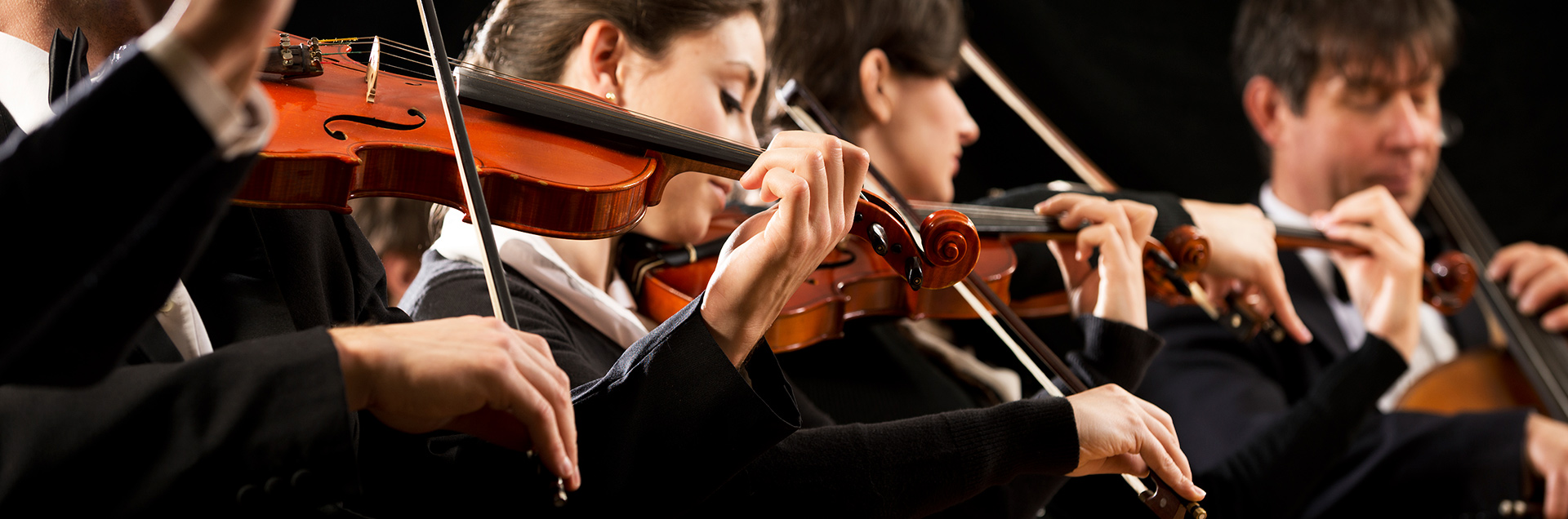 Students playing violin at a not-for-profit college or university