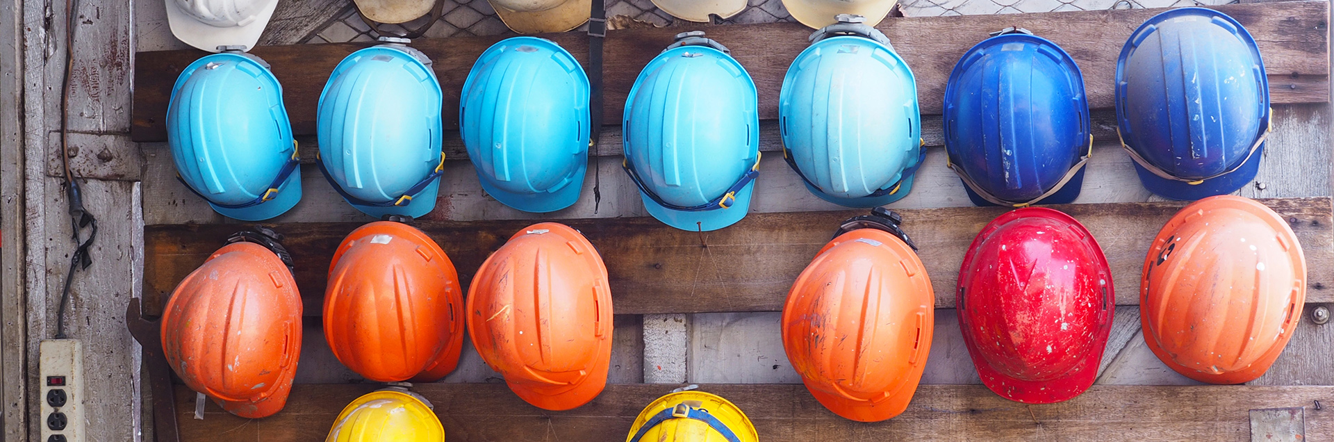 Array of hardhats representing construction workers